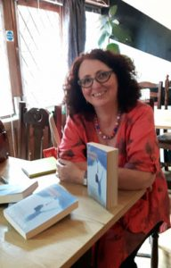 At Writers' Cafe with copies of my novel, The Arrogance of Women